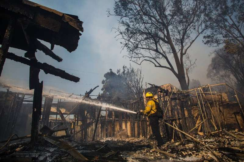Firefighters battle the Getty Fire threatening homes in the upscale neighborhood of Brentwood, California on October 28, 2019