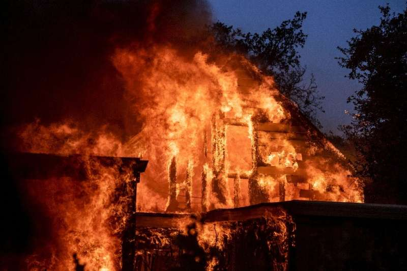 A home is engulfed in flames as the Kincade fire continues in Healdsburg, California