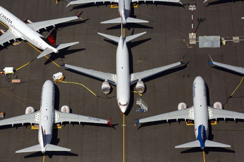 Boeing reported a sharp drop in third-quarter earnings due to the 737 MAX grounding, but said it still expects regulatory approv