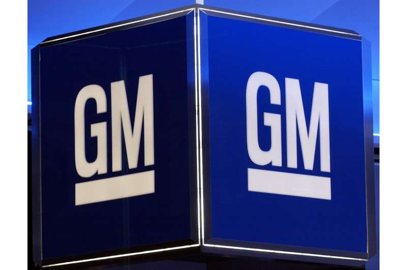 General Motors reported better-than-expected earnings on strong auto sales, but trimmed its full-year forecast due to the hit to
