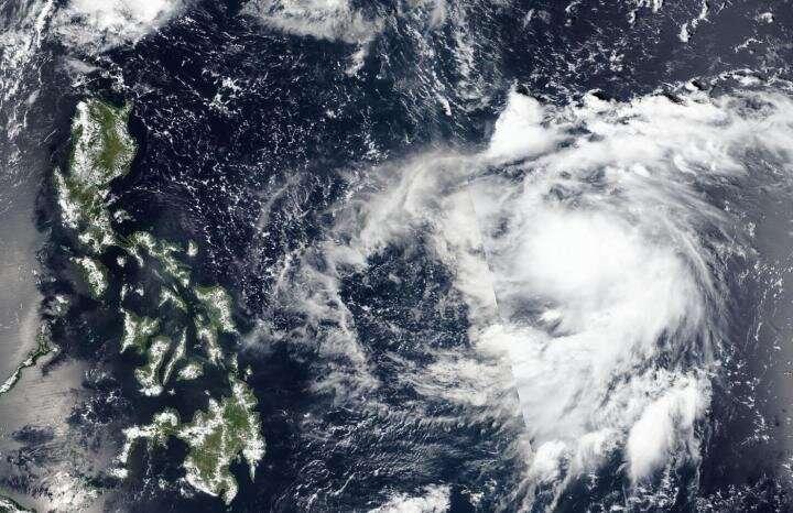 NASA-NOAA satellite sees Tropical Depression 19W organizing
