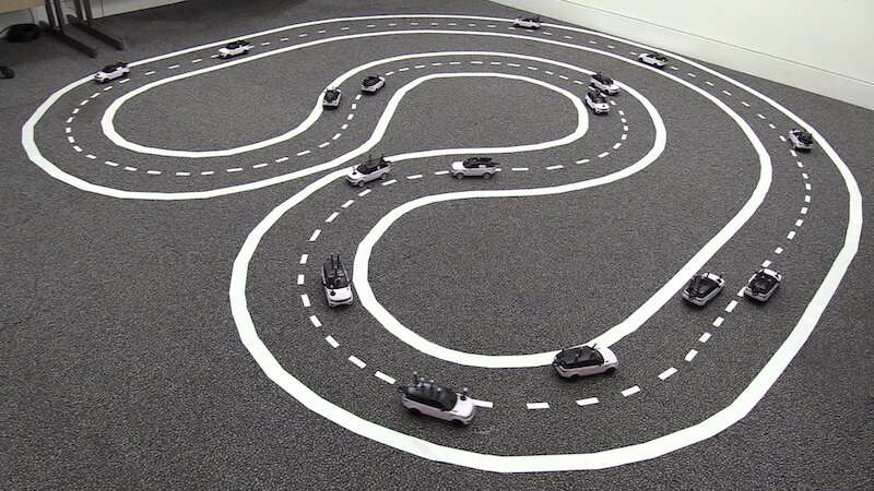 **Researchers develop a fleet of 16 miniature cars for cooperative driving experiments