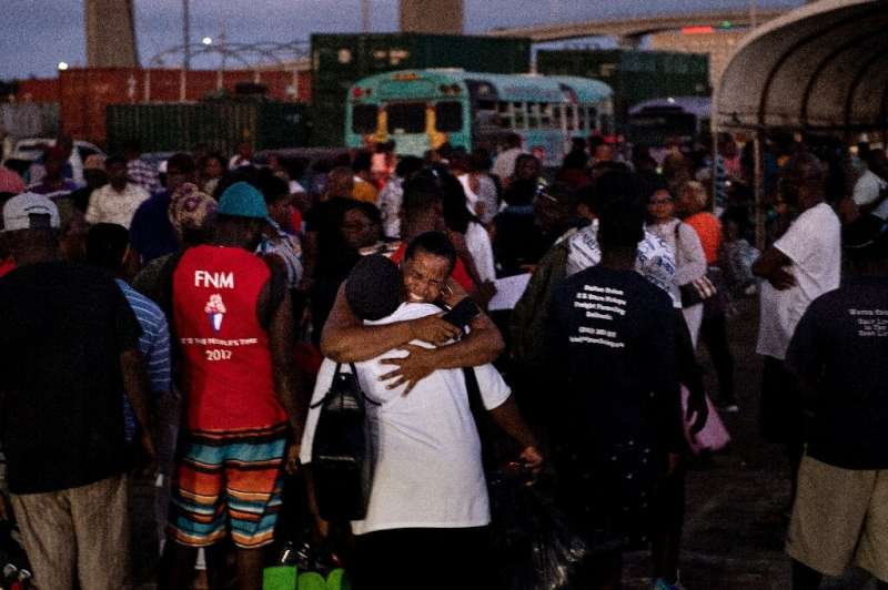 Hurricane Dorian refugees arrive at the Kendal GL Isaacs National Gym on September 6 in Nassau