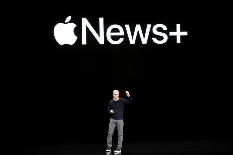 Apple CEO Tim Cook introduces Apple News+ during a launch event at Apple headquarters on Monday
