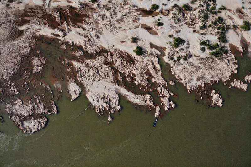 Experts say the dam-building frenzy in China and Laos has compounded the drought