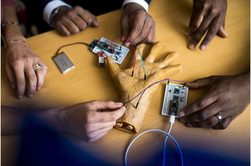 Researchers develop secure method for sending sensitive personal data from wearable tech—send it through the body.
