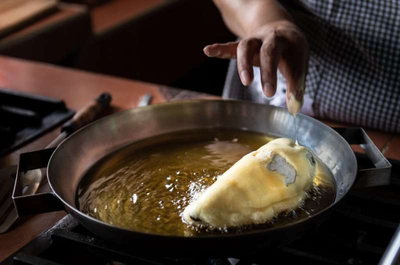 """A chef prepares """"Chile en Nogada"""" in San Andres Calpan, Puebla state"""