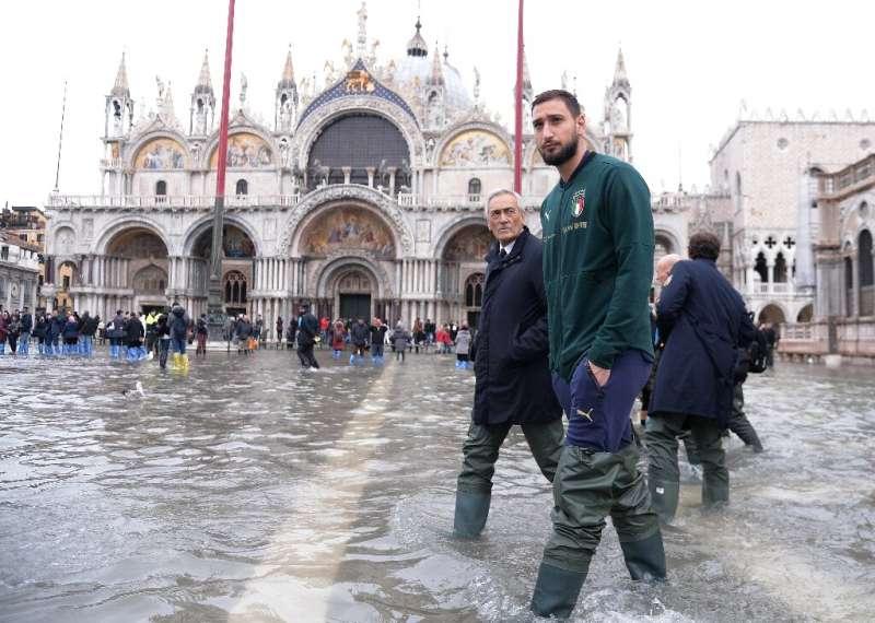 AC Milan goalkeeper Gianluigi Donnarumma waded through flood water in St. Mark's Square