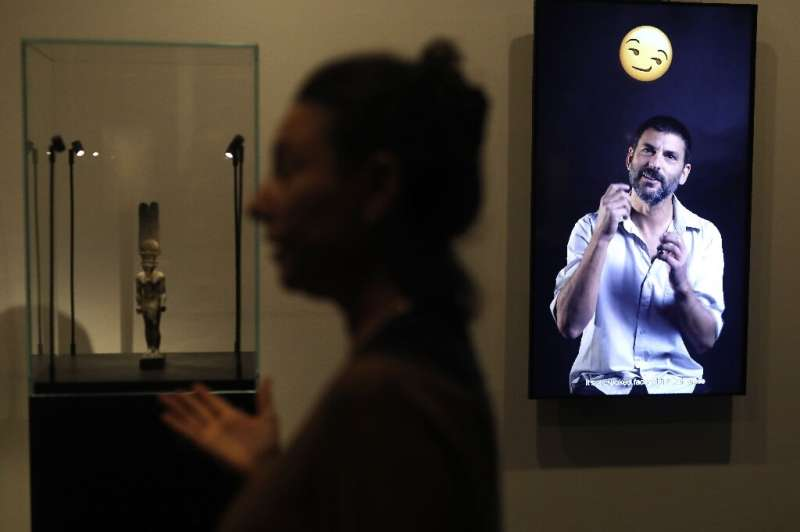 """A curator presents the exhibition """"Emoglyphs: Picture-Writing from Hieroglyphs to the Emoji"""" at the Israel Museum in J"""