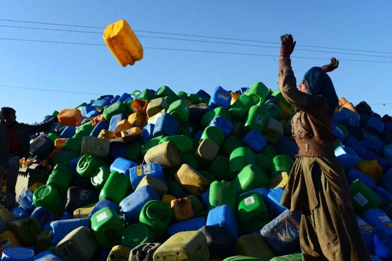 Afghan labourers work at a plastics recycling factory in Herat