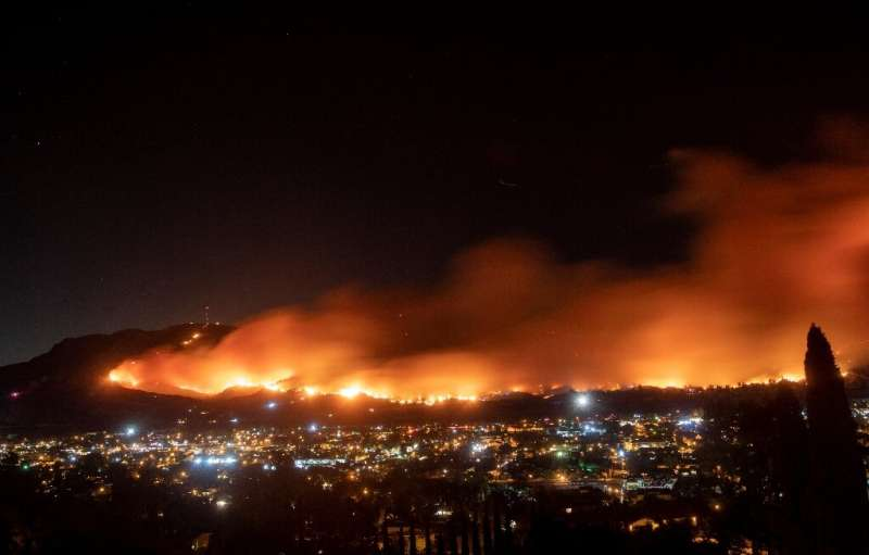 A long exposure photo shows the Maria Fire as it races across a hillside in Santa Paula, California on November 1, 2019
