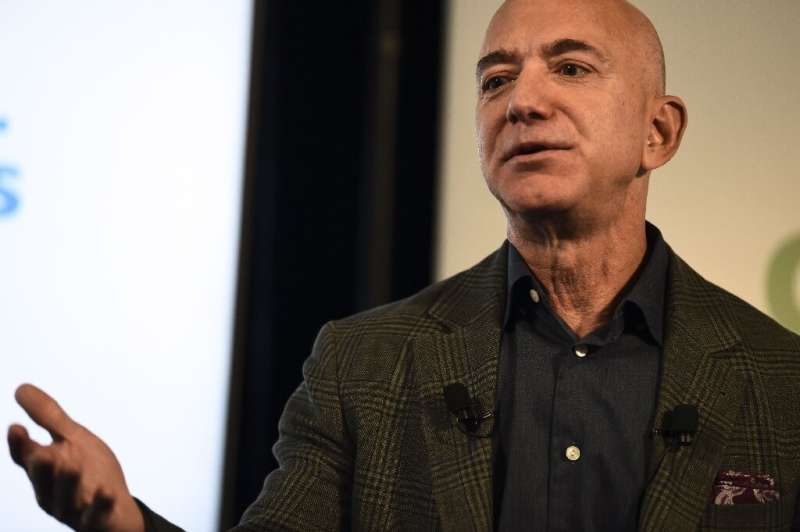 Amazon, whose founder and CEO Jeff Bezos is seen here, set out a series of principles on corporate responsibility, including cal