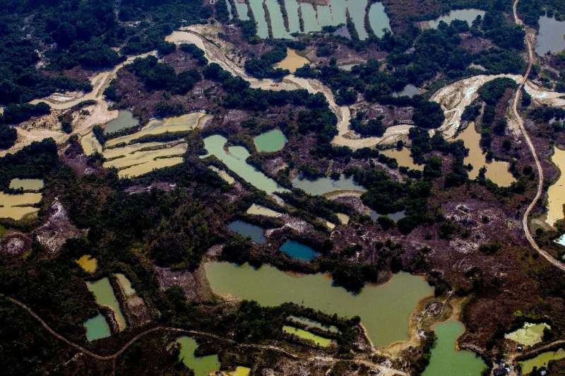 An aerial photo taken on August 28, 2019 shows the Esperanca IV informal gold mining camp in the Amazon basin in Brazil