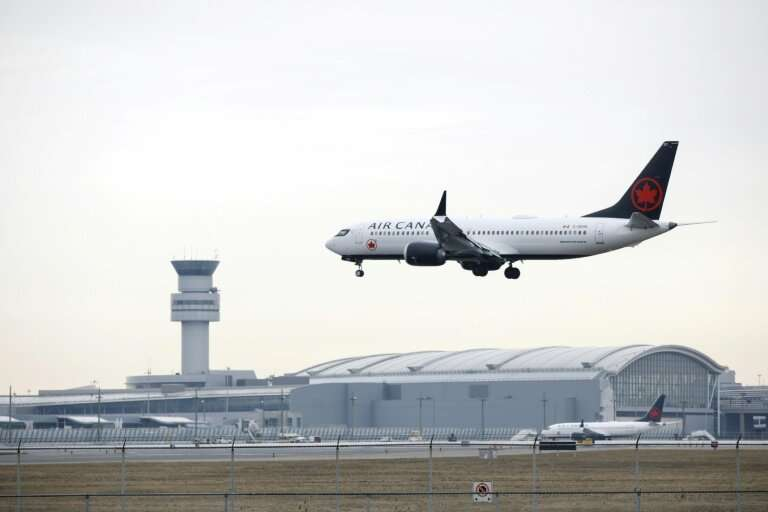 An Air Canada Boeing 737 MAX 8 jet approaches Toronto Pearson International Airport on March 13, 2019, before a worldwide ground