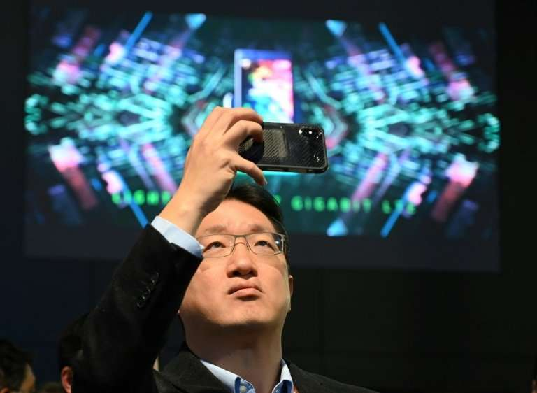 An attendee takes photos on the first day of CES 2019 on January 8, 2019 at the Las Vegas Convention Center