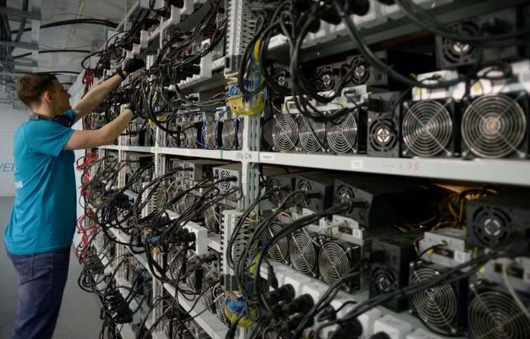 """An employee inspects machines for the production of Bitcoin and Lightcoin at the """"Kriptounivers"""" (CryptoUniverse) mini"""