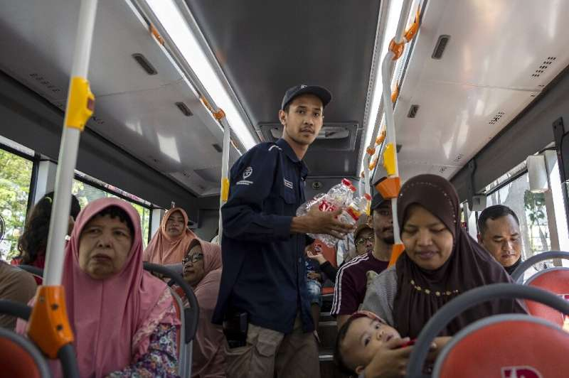 An hour-long bus ride with unlimited stops costs three large bottles, five medium bottles or 10 plastic cups in an Indonesian re