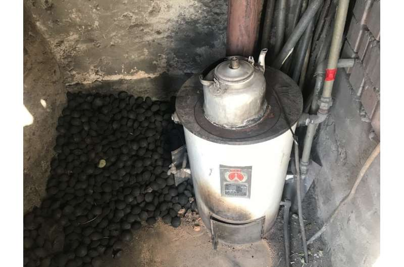 As China rapidly adopts clean energy, use of traditional stoves persists