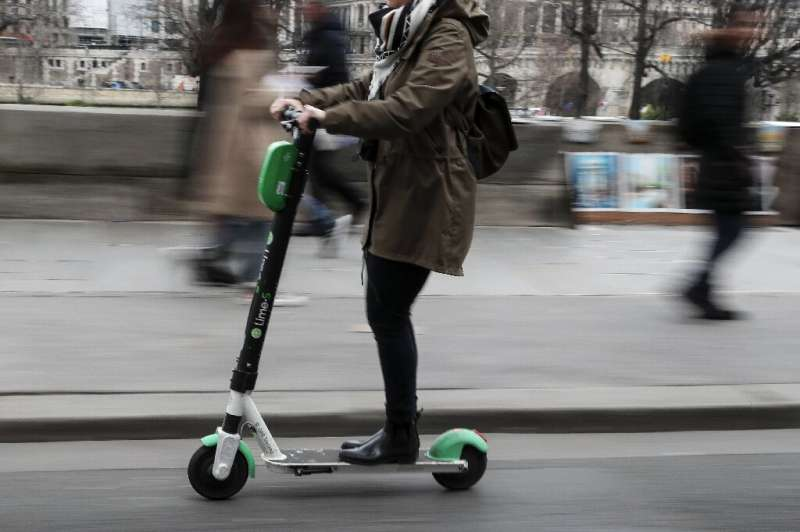 A woman uses an electric scooter of the US company in Paris - but the short lifespan of the vehicles is proving a big issue