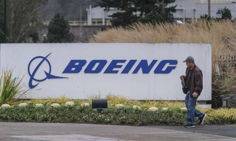 A worker leaves the Boeing 737 factory in Renton, Washington the same day the company announced a temporary shutdown of the plan
