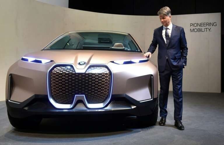 BMW's CEO Harald Krueger with the German carmaker's Vision iNEXT concept car, an all-electric and highly automated vehicle