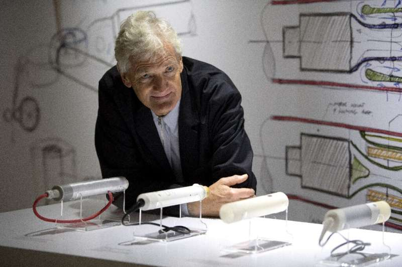 British industrial design engineer and founder of the Dyson company, James Dyson, posing with some of his products last year