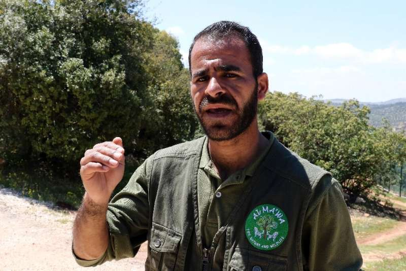 Caretaker Khaled Ayasra (pictured) says that when the animals arrive they remain scared of aircraft noise after their experience