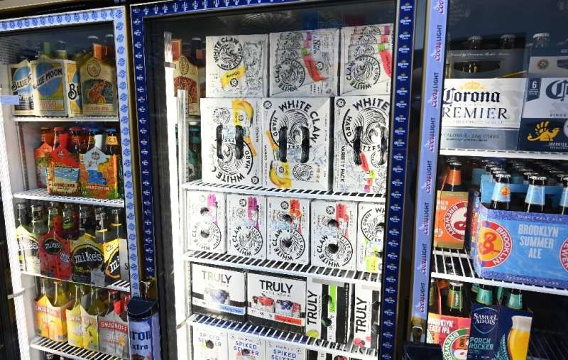 Cartons of White Claw, Truly and Bon & Viv spiked seltzer are on display at the Round The Clock Deli in New York—the alcohol