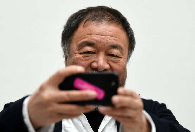 Chinese artist Ai Weiwei has used selfies as a political tool—here, he takes one at a press conference in Dusseldorf, Germany in