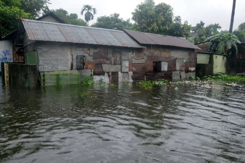 Dozens of people have died and thousands displaced by monsoon floods in India