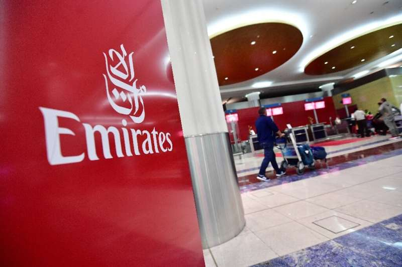 Emirates Airline blamed high fuel prices and a strong dollar for the sharp fall in its net profits