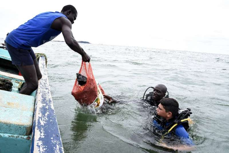 Farewell, rubbish: Scuba divers bring up plastic waste and other items collected from a bay off Dakar