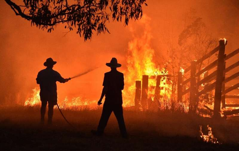 Fires have raged across a huge area of eastern Australia, laying waste to bush, farmland and people's homes