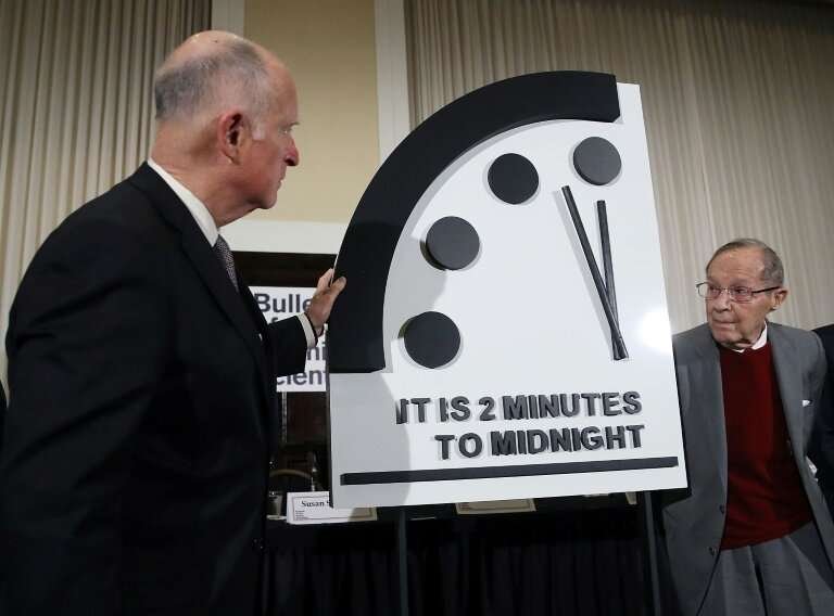 Former California Governor Jerry Brown (L) and former US Secretary of Defense William Perry unveil the Doomsday Clock during The