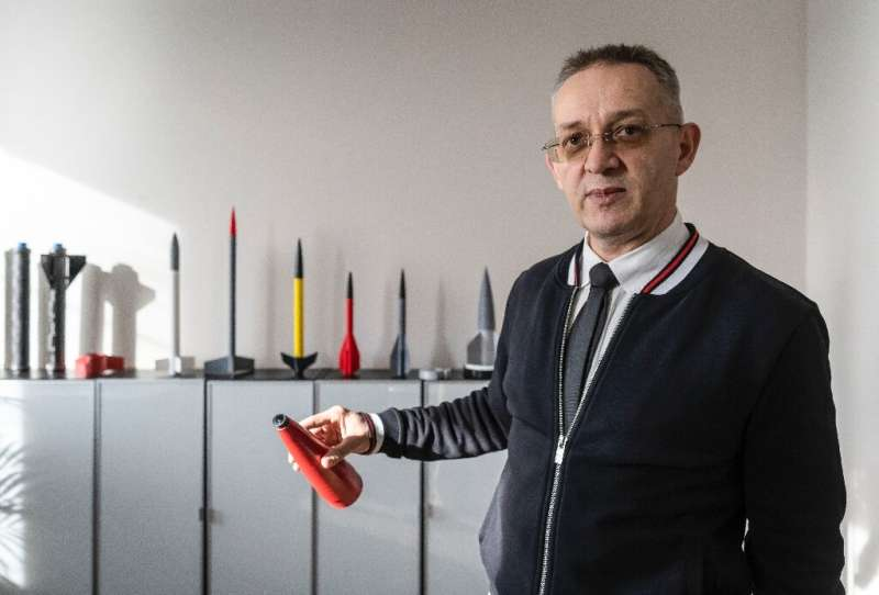 Founder and chief inventor of Polish firm Spartaqs Slawomir Huczala poses with parts of an Aerostatic Rocket Launcher (ARL) dron