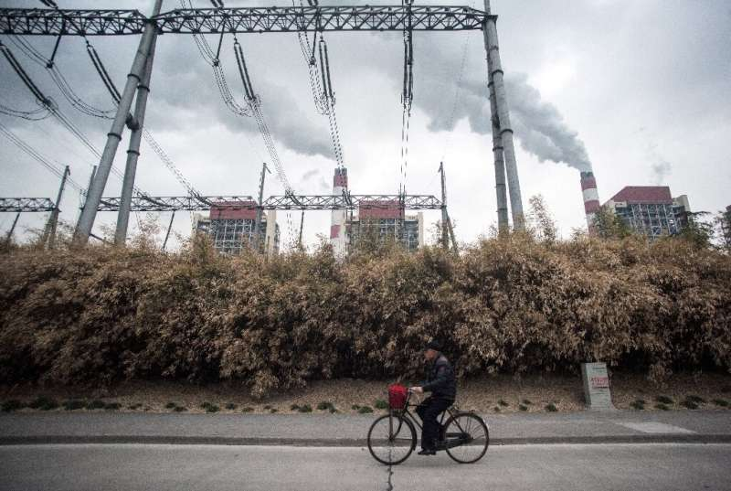 Global coal-fired electricity from plants like this one in Shanghai, China, could see a record fall this year
