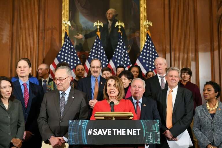 House Speaker Nancy Pelosi (C) and other Democratic lawmakers speak at a news conference unveiling a bill that would restore US