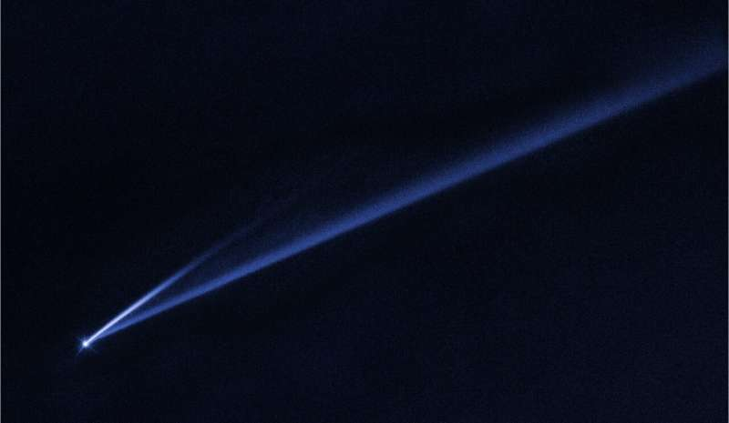 Hubble watches spun-up asteroid coming apart