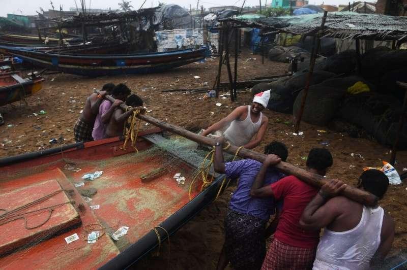 Indian fishermen secure their boats in Puri before Cyclone Fani makes landfall