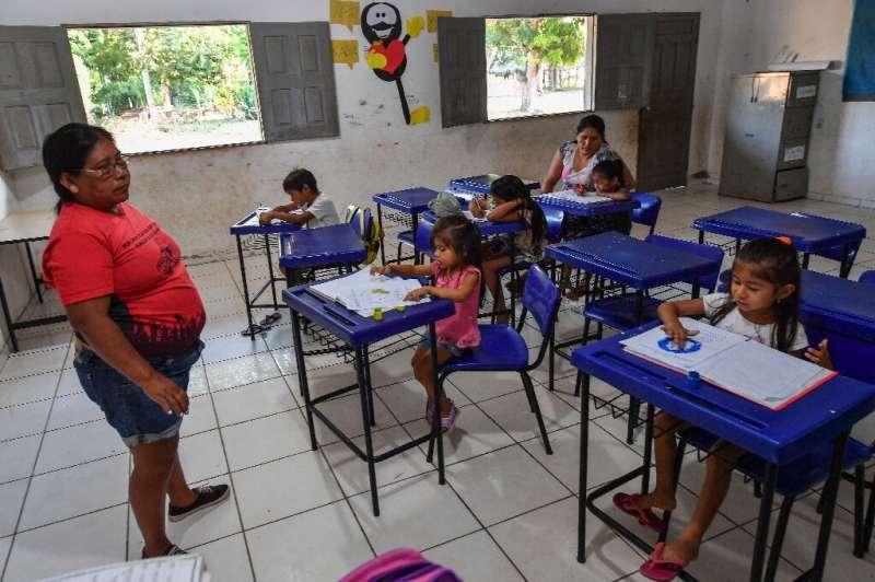 Indigenous teacher Claudeth Gabriel Sau Munduruku, who works at school in the Praia do Mangue indigenous reserve, isn't sure the