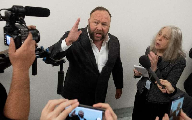 Infowars founder Alex Jones, banned by Facebook Thursday, has developed an online following for espousing conspiracy theories ab