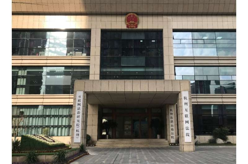 Inside the Hangzhou Internet Court, litigants appear by video chat as an AI judge - complete with on-screen avatar - prompts the