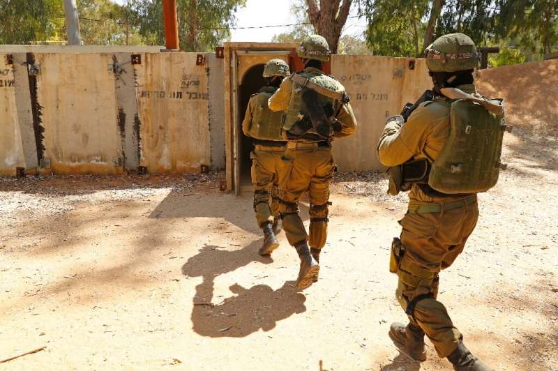 Israeli soldiers enter a  mock enemy tunnel as part of a combat exercise