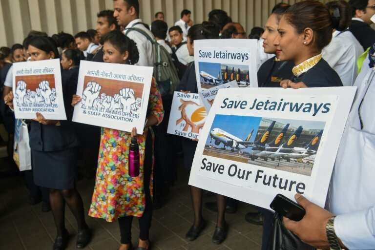 Jet Airways employees hold placards as they gather for a protest march at the Chhattrapati Shivaji International Airport, in Mum