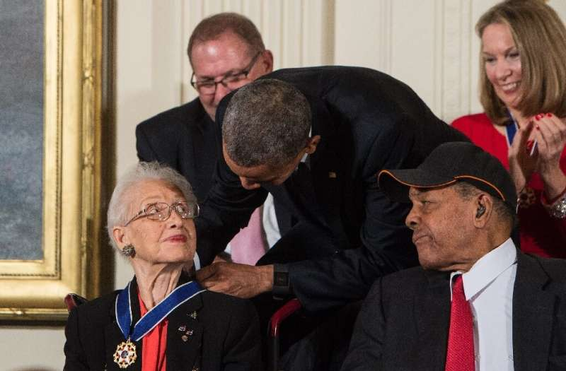 Katherine Johnson, seen here receiving the Presidential Medal of Freedom from Barack Obama, provided pivotal contributions to Am