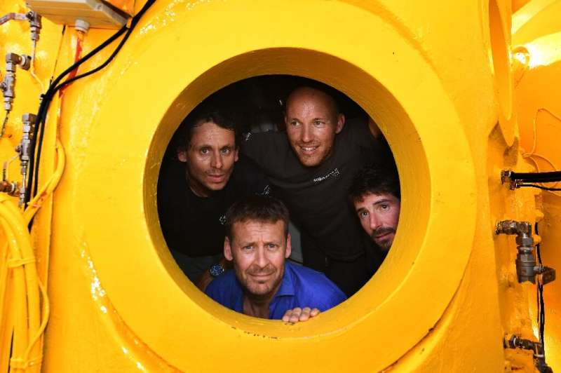Laurent Ballesta (below) was assisted by (L-R) diver and camerman Yannick Gentil, marine biologist Antonin Guilbert, and diving