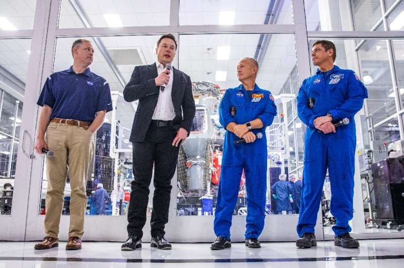 (L-R) NASA Administrator Jim Bridenstine, SpaceX founder Elon Musk, and astronauts Doug Hurley and Bob Behnken speaking during a