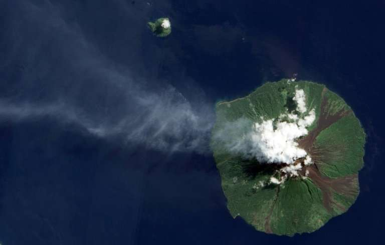 Manam island, pictured here in a 2015 eruption, is a volcanic cone that towers out of the sea north of the Papua New Guinea main