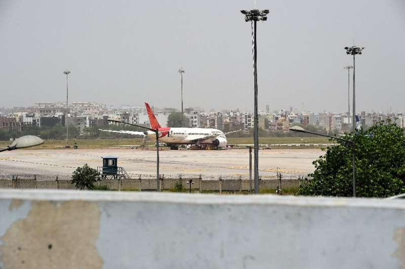 More than 80 domestic and international Air India flights were delayed because of a problem with the company's check-in software
