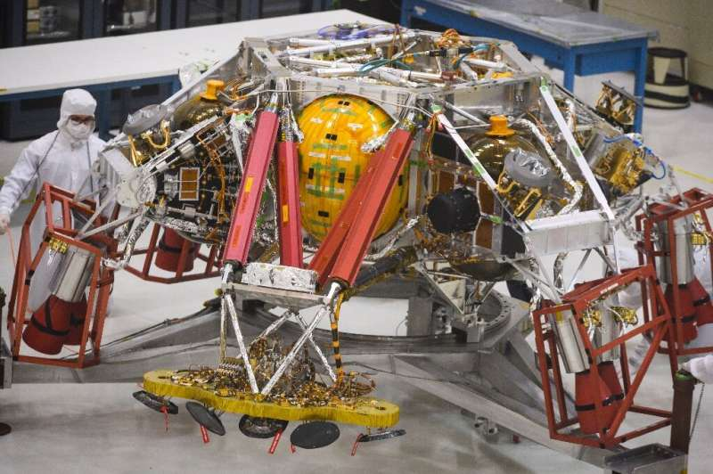 NASA engineers and technicians reposition the Mars 2020 spacecraft descent stage equipment, which will be used to land the rover